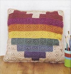 Pixel crochet rainbow heart cushion design by Hannah Meur