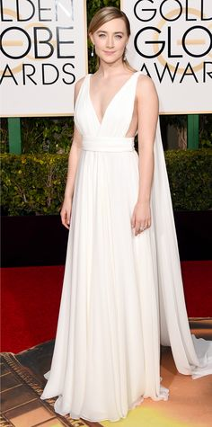 Saoirse Ronan in a white dress and Chopard jewels.