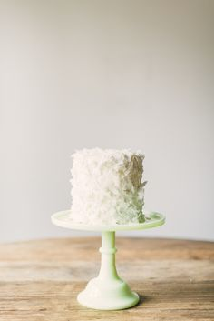 #easter, #cake-stands, #cake, #coconut, #spring  Photography: Rustic White - rusticwhite.com  Read More: http://www.stylemepretty.com/living/2014/04/17/a-blossoming-easter-tablescape/
