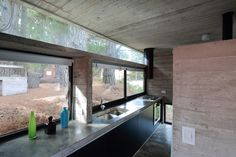 Argentine architecture firm BAK Arquitectos has created 'Pedroso House' as a small-scale dwelling located in the corner of a dense pine forest in Buenos Aires. Minimal Architecture, Interior Architecture, Interior And Exterior, Residential Architecture, Kitchen Interior, Kitchen Design, Kitchen Ideas, Steel House, Forest House