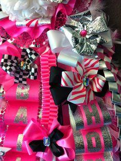 Mumsations- Pink and white senior Homecoming mum with checkered and zebra ribbon.