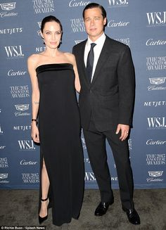 Classy: Angelina Jolie and Brad Pitt arrived in style on Wednesday evening as they appeare...