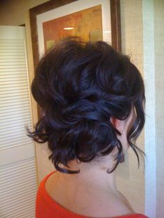 Loose, messy, wavy bun. Curl your hair, brush/comb through it lightly, wind it up loosely, and pin.