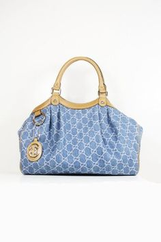 -  This authentic Gucci Blue (Denim) Canvas and Leather 211944 handbag comes directly from designer boutiques  -  Blue (Denim) Canvas and Leather   -  Top snap closure  and double handles        -  Interior lining with pocket        -  Measurements: 14W x 10H x 5D (inch)       -  This purse comes with original cards, dust bag and Gucci tag   -  Made in Italy