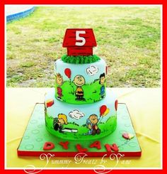 draw with edible markers on edible paper, cut out and use royal icing to attach