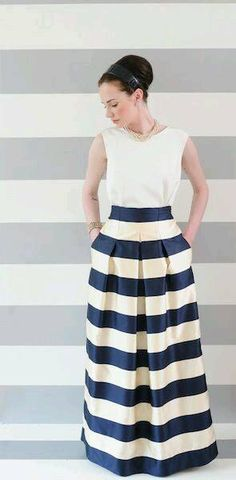 White top with a maxi stripped inverted pleat skirt