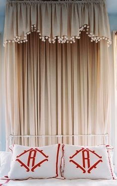 valentine's day opened me up to the beauty of red and white.  a simple palette (grey and white?) with a few red accents (like these monogrammed pillows) could work for the bedroom...