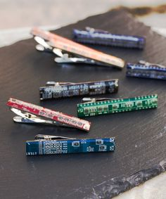 This tie bar is a gorgeous addition to classic suits that emphasizes your style and individuality. It is a great combination of geekery, modern and classic accessory. Circuit board tie bar is a wonderful gift to your dearest one.  This tie clip is made of a real circuit board piece (approx. 2 1/8 x 3/8 (55 x 9 mm) with its back made of palladium plated metal. It is covered with clear resin, so the surface is as shiny as a glass. Palladium plated supplies dont tarnish and change color.  There…