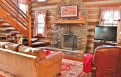 This newly improved plus loft, log home defines rustic charm with vaulted great room boasting a floor to ceiling stone wood burning fireplace and wide plank wood floors. Log Cabins For Sale, Cabins In The Woods, How To Build A Log Cabin, Log Cabin Furniture, Metal Furniture, Log Home Decorating, Log Cabin Homes, Loft, Country Style Homes