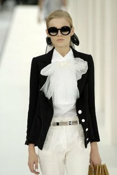 chanel...black and white.  Travel light but always look put together...leave the jeans for yard work
