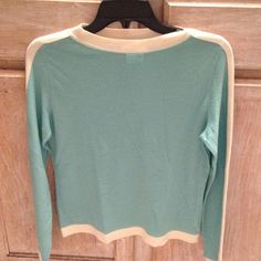 DODO + Angelika wool sea foam green sweater Sheer lightweight wool. Sea foam green/ cream outline. Sheer almost see through. In great condition.One spot of dark thread on the inner sleeve.Made in Italy. States large but fits more like a medium or even small. DoDo + Angelika Sweaters