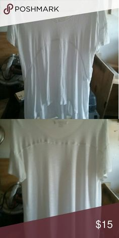 NWOT hi low tunic This is a beautiful lightweight high low white v-neck shirt / tunic. Never worn Tops Tunics