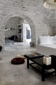 Trulli Summer House in Alberobello, Italy. I can see myself lounging next to my husband in this room.
