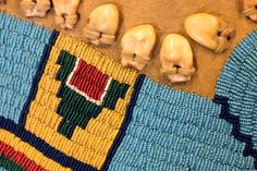 Details of a beaded elk-tooth dress from the Dyck collection at the Plains Indian Museum, Cody, WY