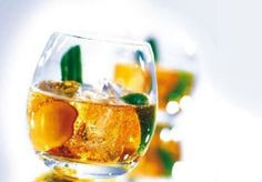 Cognac Summit - Cocktail with cognac, fresh ginger, cucumber peel and sparklink lemonade
