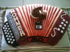 Fondant accordion cake. Carrot cake with cream cheese icing. With personal figurines from a family story. For grandfather's 80th birthday.