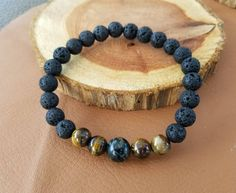 Excited to share the latest addition to my #etsy shop: Essential Oil Diffuser Bracelet, Lava Rock Beads, Gemstone Beads, Aromatherapy, Black Onyx, Gemstones, Tiger Eye http://etsy.me/2EtKVkd #jewelry #bracelet #black #evileye #brown #unisexadults #boho #paulaparrish