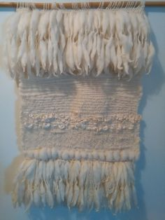 This hand woven wall hanging was made with New Zealand hand spun yarns and other.  MATERIALS : New Zealand Merino wool roving and hand spun yarns, New Zealand pure wool yarns, New Zealand kids mohair yarns, other.  MEASUREMENTS : 17.5 ( 45cm) long, 15.5(39cm) wide.  Hand woven and hand spun by me.
