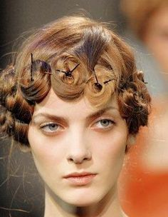easy hairstyles with bobby pins... @Laney Glover You should try this look.