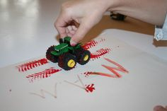 Use more than paintbrushes to paint!  This truck is easier for little hands to grasp than a brush.