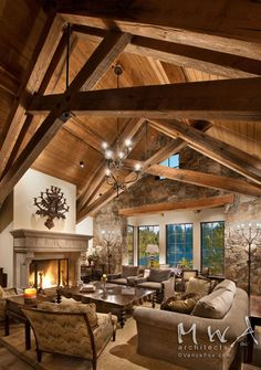 great room, heavy timber trusses, reclaimed wood, wood ceiling, stone wall