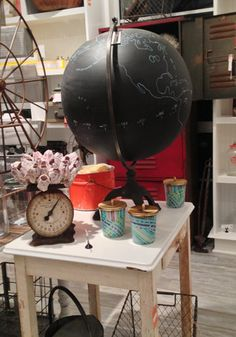 DIY it - paint globe with chalkboard paint, use turquoise paint pen to outline countries/continents as well as the measurements along the equator