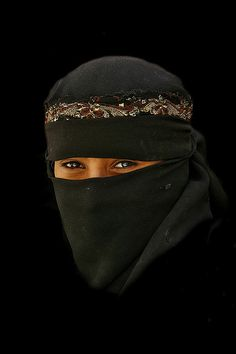 Girl smiling under her veil - Yemen by Eric Lafforgue, via Flickr