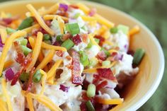 BBQ season! Woo hoo! Here's a fun recipe for loaded baked potato salad. It's a spin on the classic hearty side we all know and love.  Loaded Baked Potato Salad Ingredients 2 lbs. Yukon Gold Potatoes (Any potato you have on hand will work fine) 1 cup Plain Greek Yogurt ½ cup Mayonnaise ¼ cup Green Onion, chopped 1 cup Shredded Cheddar Cheese ½ Red Onion, chopped ½ lbs. Bacon, cooked%2