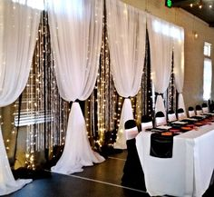 Moments In Time Wedding & Event Rentals. Head table reception backdrop ~ black mirror organza, white sheers, fairy lights and crystal curtains. Read more at : http://theweddingly.com/: