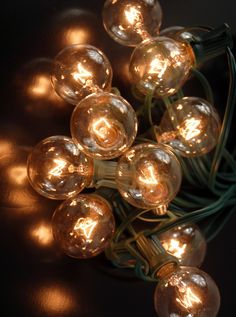 """Paper Lantern Lights (for 8"""" -14"""" lanterns)  Clear  Bulbs 25 Sockets (12"""" spacing) Green Cord (28.5')  $19.95 set / 3 for $18.95 set"""
