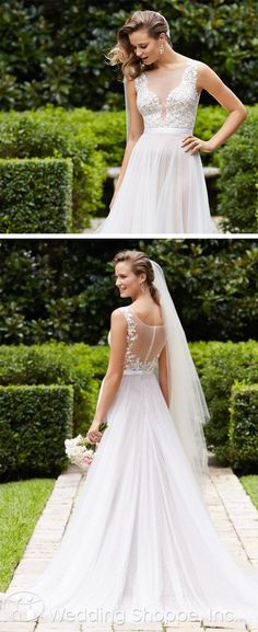 Romantic wedding dress with plunging neckline and illusion back. So gorgeous!