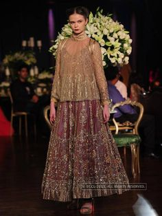 Olga P showcases a creation by designer Manish Malhotra on Day 5 of Delhi