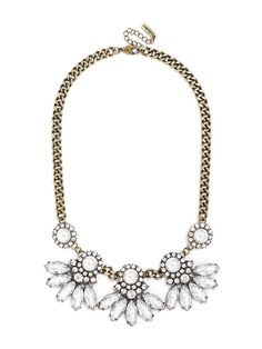 A statement necklace formed from pearls surrounded by countless crystals is the perfect base for feathery petals.
