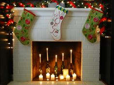 Charming Christmas Stocking Design Ideas : Enticing Three Christmas Stocking Design Idea with Red Mesh Ribbon and String Lights also Christmas Garland on Gorgeous Christmas Fireplace Mantel Decor Fireplace Filler, Fireplace Candle Holder, Candles In Fireplace, Fireplace Ideas, Fireplace Decorations, Mantle Ideas, Fireplace Surrounds, Fireplace Design, Unused Fireplace
