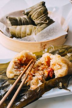 Our detailed, step-by-step Cantonese-style Zongzi recipe, a traditional Chinese savory sticky rice treat with pork, peanuts, and salted duck egg yolk eaten during the Dragon Boat festival. Dim Sum, Chinese Sticky Rice, Chinese Pork, Wok Of Life, Asian Recipes, Ethnic Recipes, Hawaiian Recipes, Asian Foods, Chinese Recipes