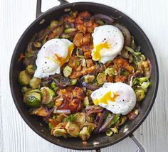 Sweet potato & sprout hash with poached eggs This quick and easy pan-fried dish uses up leftover Brussels sprouts for a delicious Boxing day brunch, or a low fat, low calorie weeknight dinner Bbc Good Food Recipes, Egg Recipes, Vegetarian Recipes, Cooking Recipes, Healthy Recipes, Healthy Foods, Sprout Recipes, Recipies, Brunch
