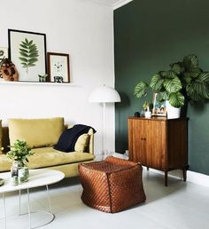 bohemian home decor. look the casual look and all the plants. casual living room home decor