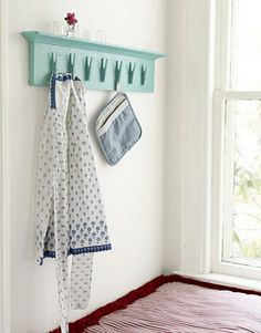 mounted clothes pins. use for storage or hang kids artwork.