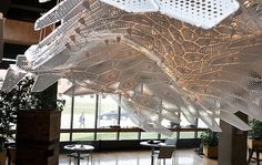 """""""EXOtique"""" is a lit, component-based, drop ceiling installed in the west entrance of the campus' architecture building in Ball State University."""