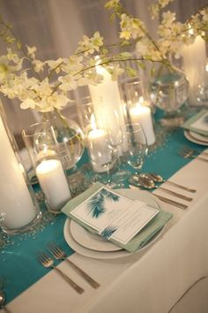 Teal and white wedding -- may not be rustic enough but love this table setting :)