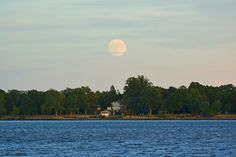 The moon rose over the Delaware River and Delanco, NJ. about 30 minutes before the sun set.