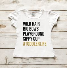 #TODDLERLIFE Sparkle Shirt Wild Hair, Big Bows, Playground, Sippy Cup, #Toddlerlife. Item Description: - Available in White. - Available in Short Sleeve. - Made of 100% Cotton. - Machine wash tumble d