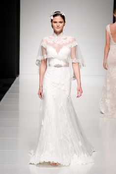 If you want a more subtle take on the cape trend, consider this gown from Annasul Y, which comes with a bridal cover up in the form of a vintage inspired lace capelet.