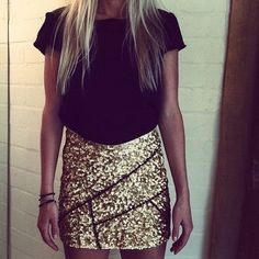 Cute black shirt with a gold sequin skirt perfect for a date night