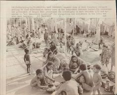 """Beniapol, East Pakistan: General view of East Pakistani refugees sitting at food distribution center here on the India-East Pakistan border. The secessionist government of Bangla desh proclaimed its sovreignty in East Pakistan 4/13 and appealed to """"all democratic countries"""" for recognition and assistance in the civil war with West Pakistan"""