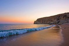 The sun setting on New Golden Beach on the island of Paros in Greece. Places Around The World, Around The Worlds, Paros Greece, Paros Island, Places In Greece, Greece Islands, Old Movies, Ocean Beach, Vacation Spots