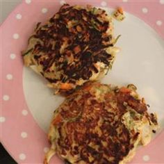 Low-Cal Zucchini Pancakes with Low-Fat Basil Dressing.....sub out a veggie like red pepper for the carrots