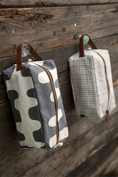 """Echo Charcoal Travel Case LG: 9"""" x 4.5"""" x 4.5"""" Printed on recycled canvas with eco-friendly pigment inks. Ideal for toiletries and travel essentials. The interior waterproof lining makes cleaning a br"""
