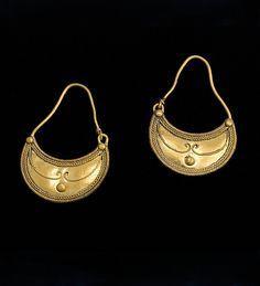 A pair of lunulaform gold earrings:                                                                                                                                                                                                                                 Gold.  Roman, 2nd - 3rd Century AD.