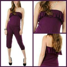 Ruffled Romper Purple strapless romper.   Has ruffled edge along the top in Knickerbocker length.    Fun and Flirty.  Rayon/Spandex Blend Pants Jumpsuits & Rompers